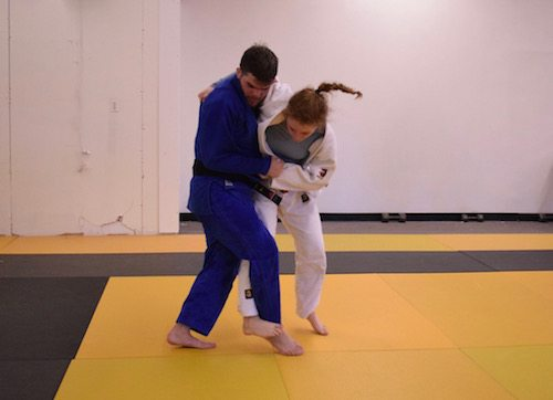 Two-time judo Olympian Nick Delpopolo playing judo with Julia Gould, a Carver student.