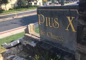 Driver crashes into St. Pius X sign